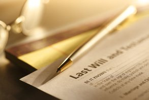 an image of a Last Will and Testament document with gold pen sitting on top of the page